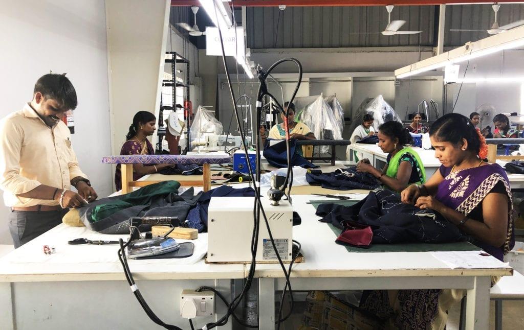 Tailors at work in MSR Garments' workshop