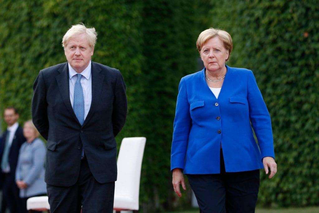 British Prime Minister Boris Johnson (left) with German Chancellor Angela Merkel
