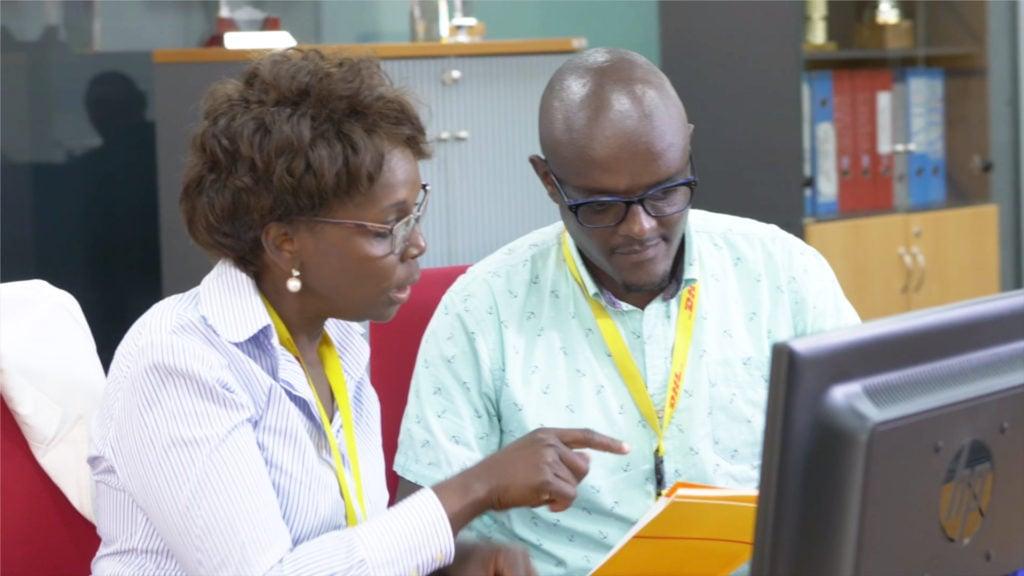 Agnes Kilei (left) guiding Moses Kiara at work