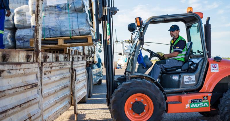 DHL GoHelp disaster response volunteer moving cargo