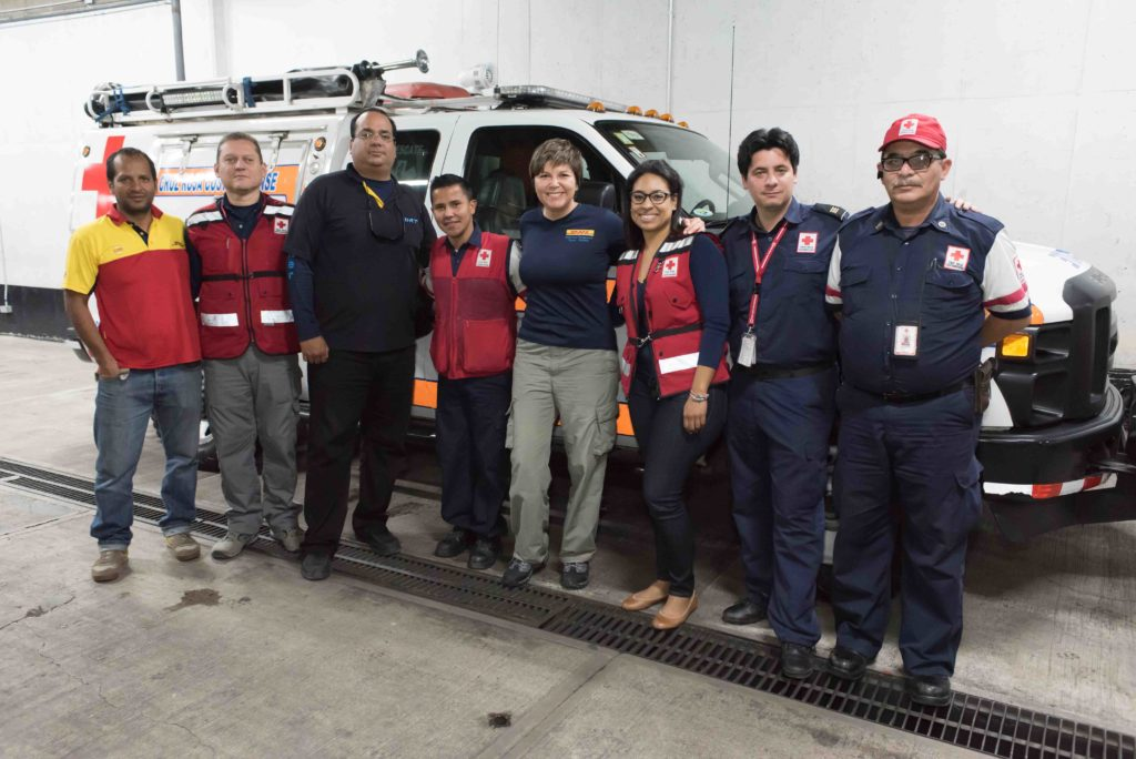 DHL volunteers in Costa Rica with red cross