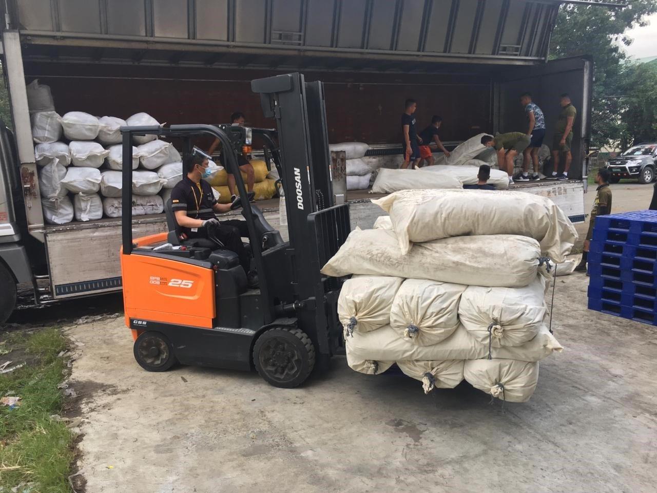 Typhoon Goni Loading supplies