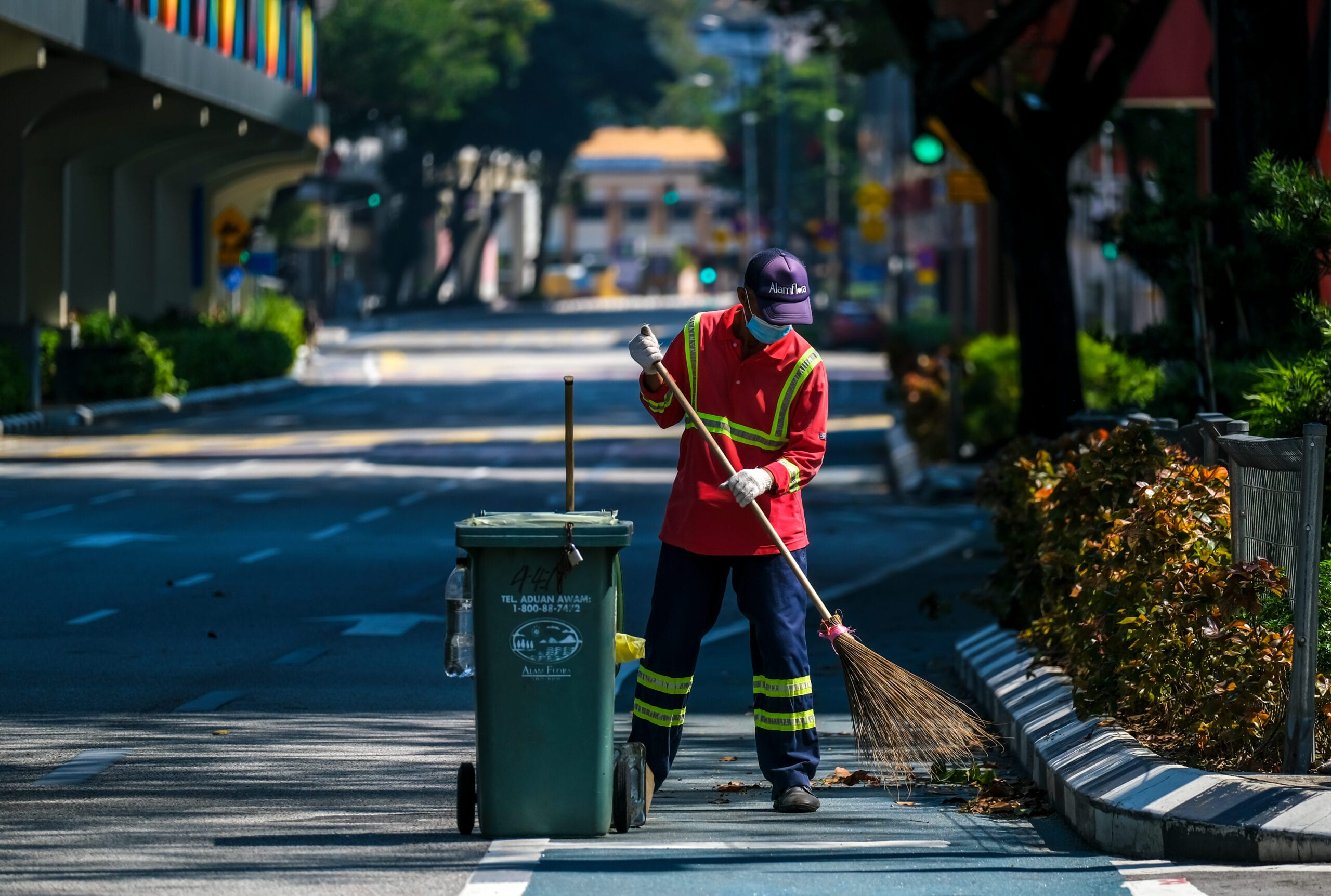 A worker cleaning Kuala Lumpur's empty streets during Malaysia's Movement Control Order (MCO) lockdown last year
